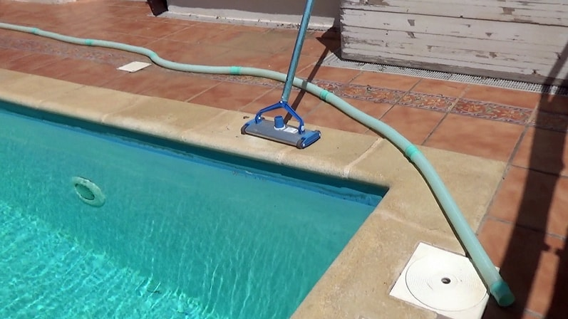 How to remove air from a pool vacuum hose - lay out the hose