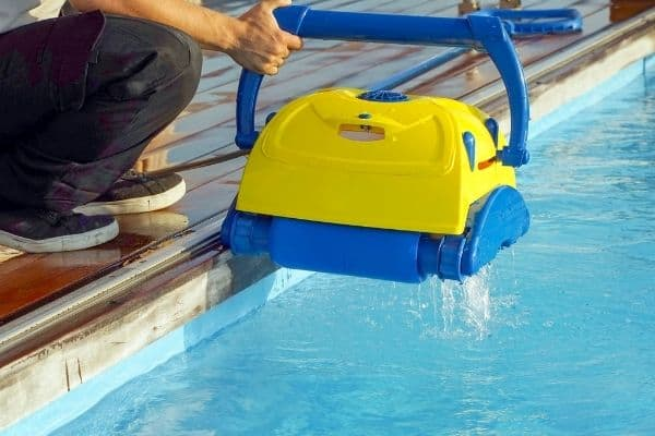 You do not need to remove the skimmer basket when using a robotic pool cleaner